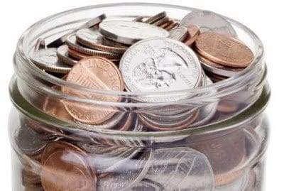 a-jar-full-of-coins-with-clipping-path